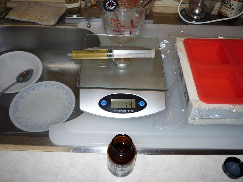 14 c c syringe on scale, reading 14 grams