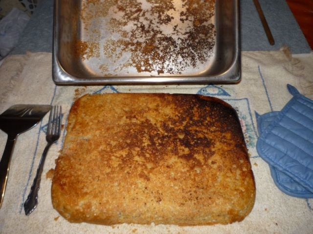 Pan with bread removed, and bottom of bread.